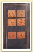 Porta di Apollo, 2000, legno e sei formelle in terracotta, cm 228x136.jpg